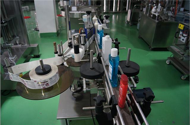 自動縦型丸瓶ラベリングマシンの構成
